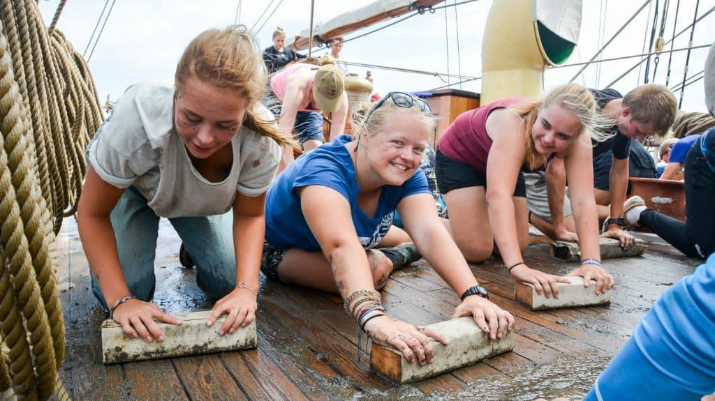 2017 Mar 5 Amanda, Maggie, Andrea Holy Stoning Aft Deck [Photo by Kelsey Hamel]
