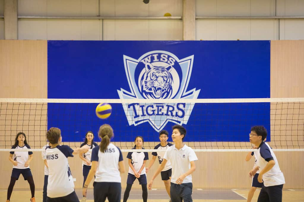 WISS students playing volleyball