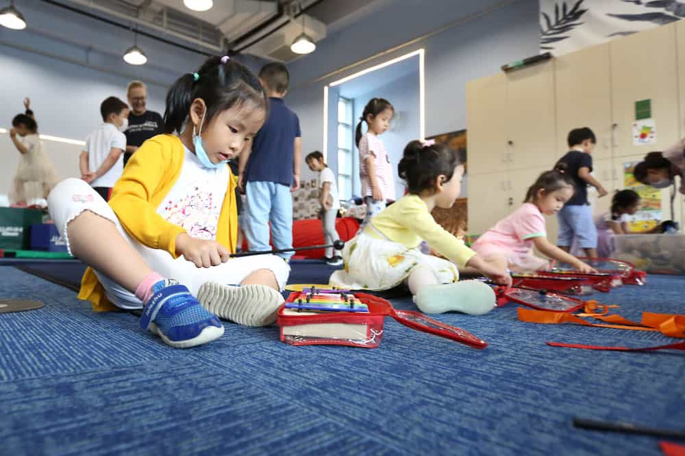 Young students at Concordia playing music to promote healthy brain development