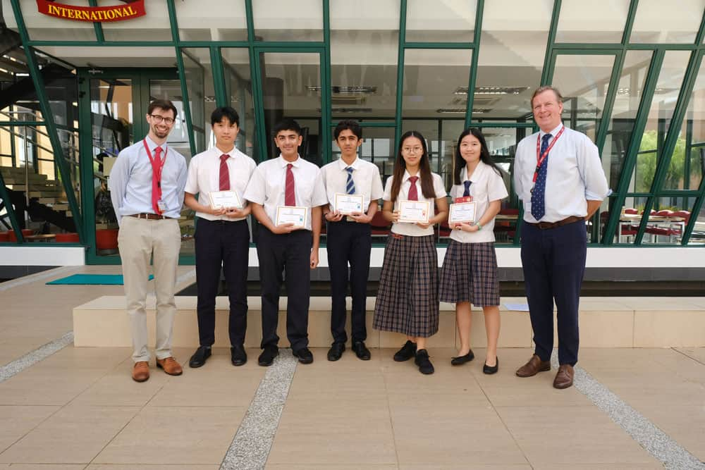Gold Award winners with JIS Principal, Mr Nicholas Sheehan and Head of Mathematics, Mr Phil May