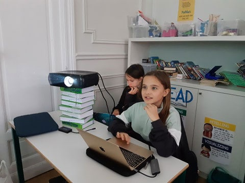 PYP4 students learning through technology using their laptops