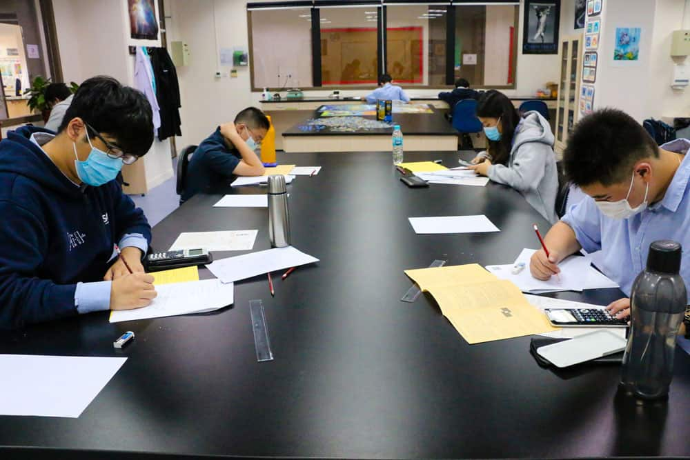 Students enjoying challenging mathematics problems