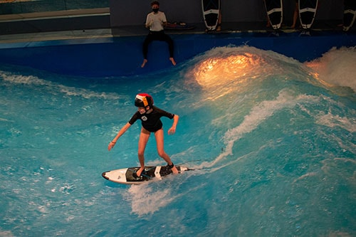 Students practice water sports during physical education